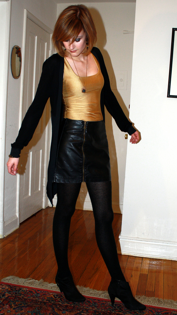 gold tank top and leather skirt