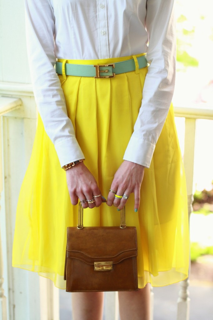 mixed rings and vintage purse