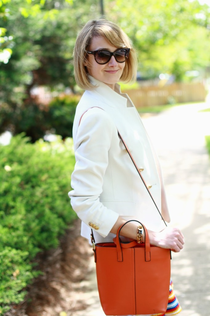 cat eye sunglasses and white blazer