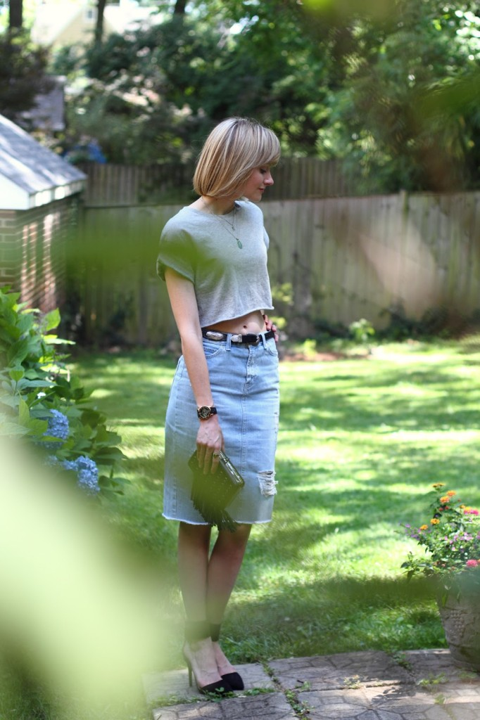 crop top and distressed denim skirt