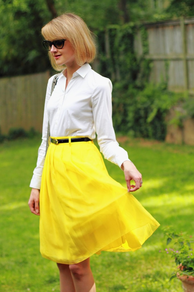 white button-down and yellow skirt