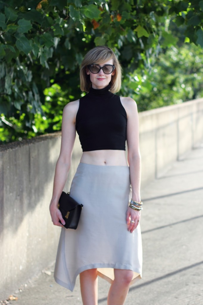 ASOS crop top, asymmetrical skirt, and Sophie Hulme bag