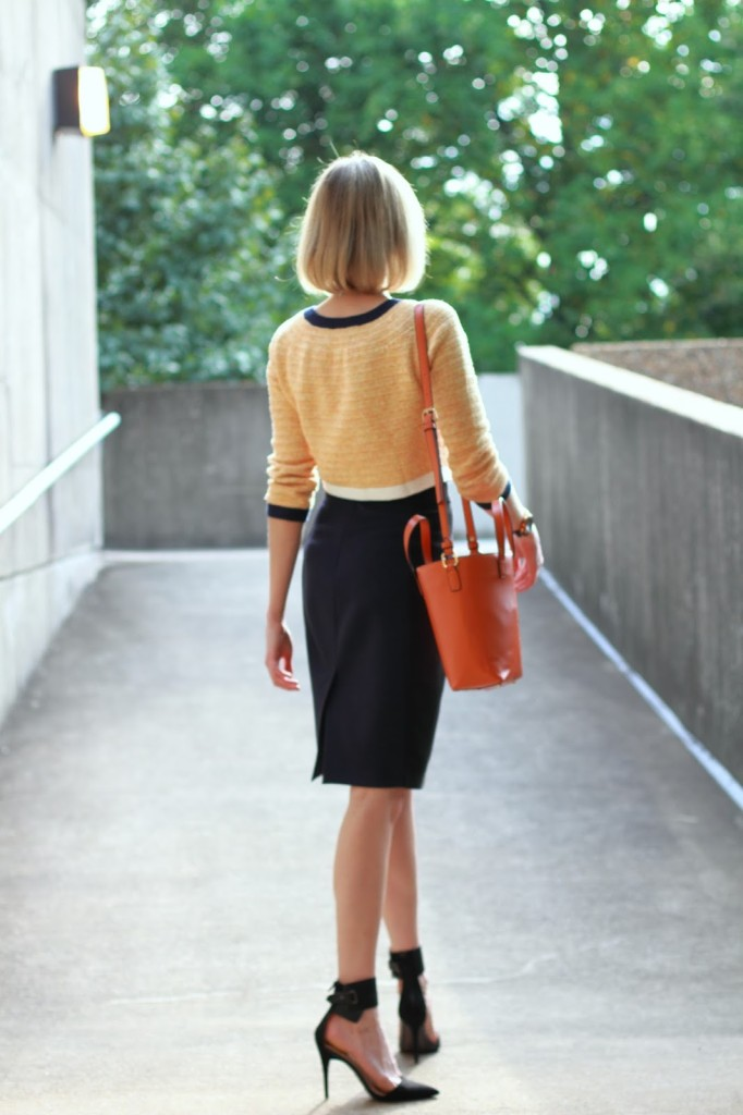 orange and navy work outfit with ankle strap pumps