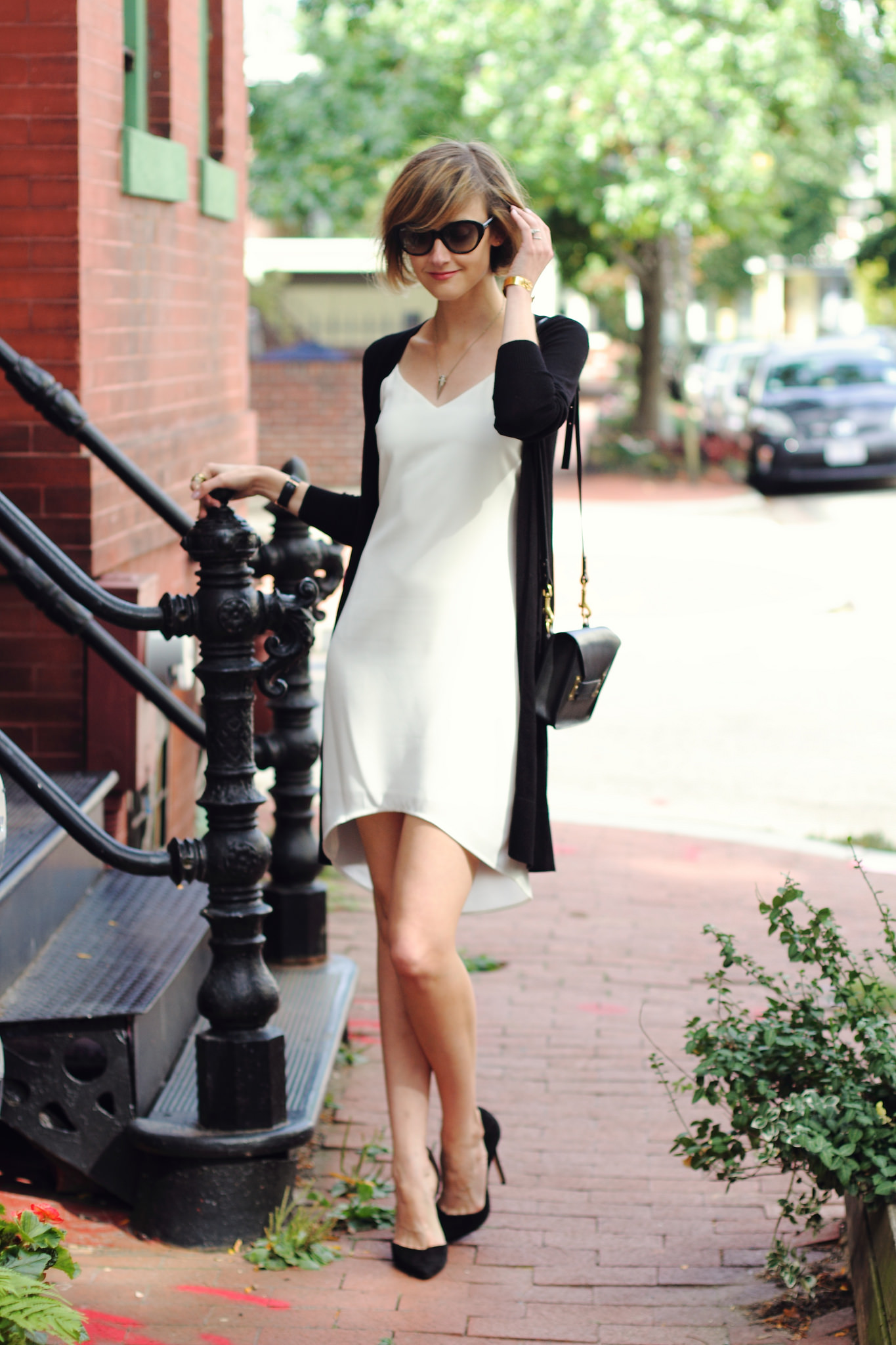 white Oasis slip dress and oversized cardigan