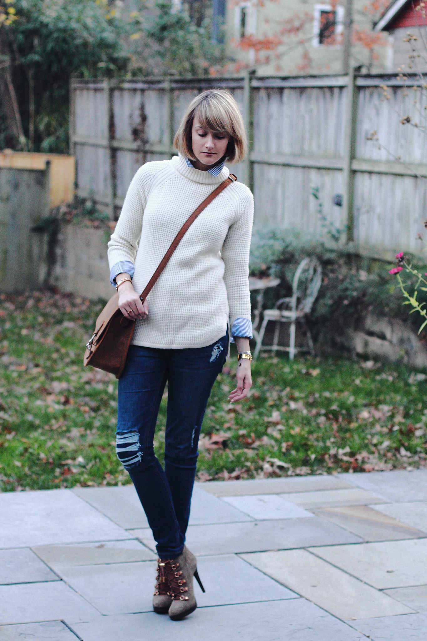 Banana Republic sweater and Saddleback Leather bag