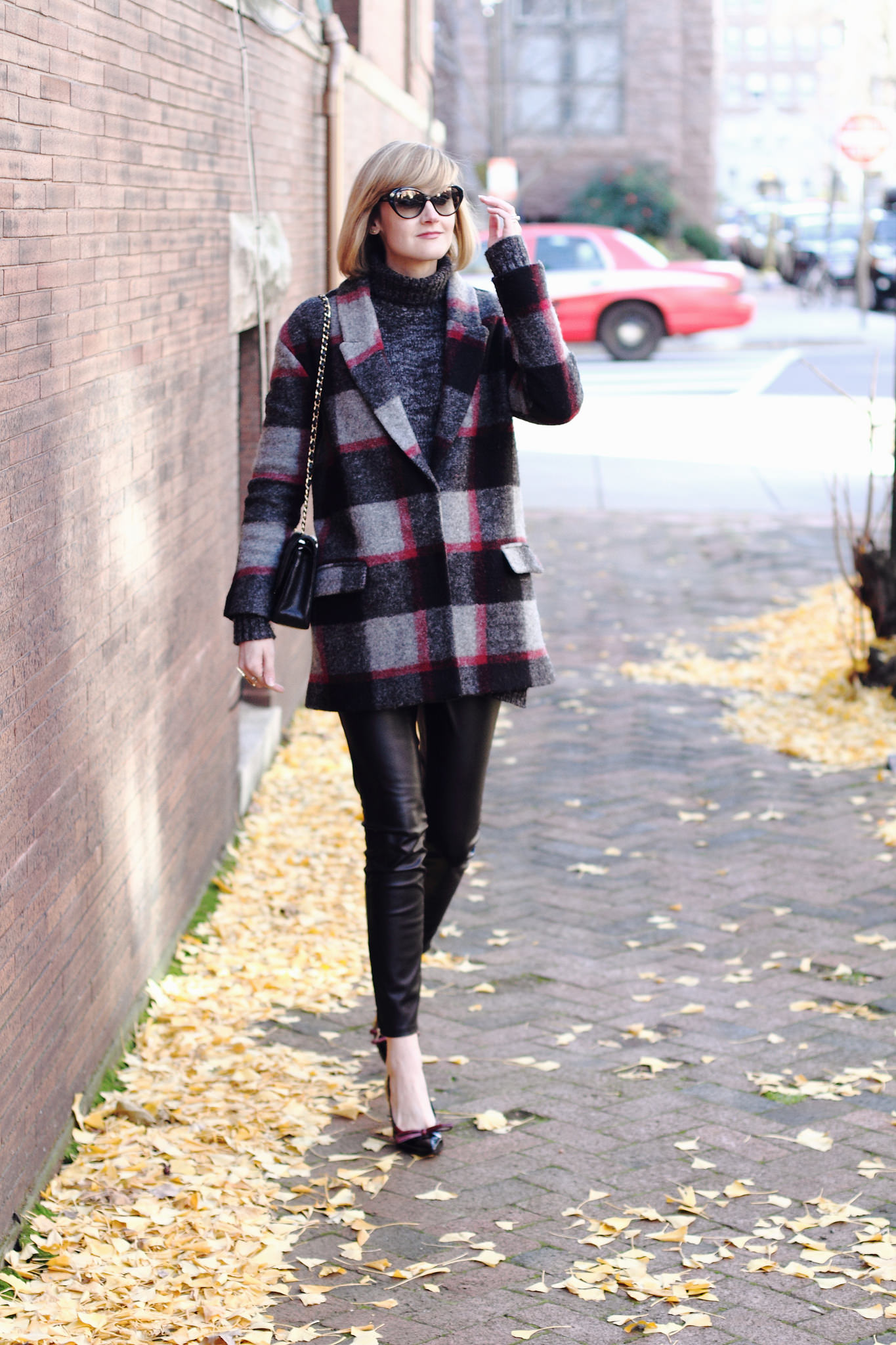 plaid coat and leather leggings