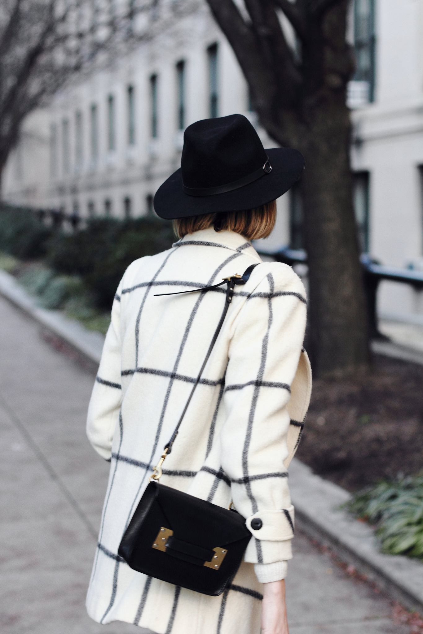 vintage check coat and black fedora