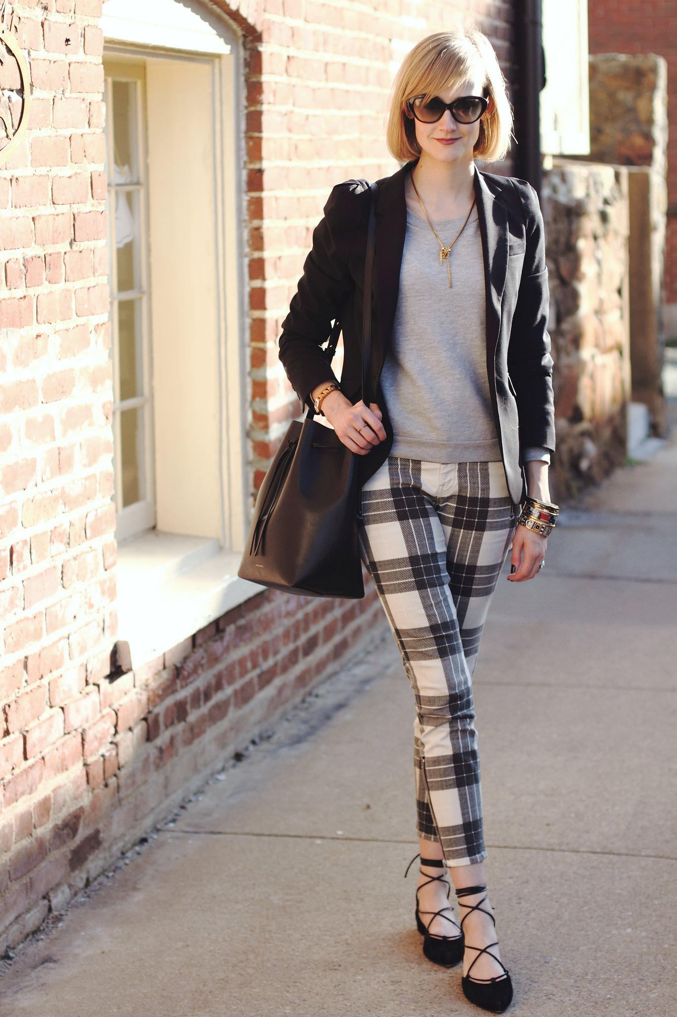 plaid Mother jeans and Stuart Weitzman lace-up flats