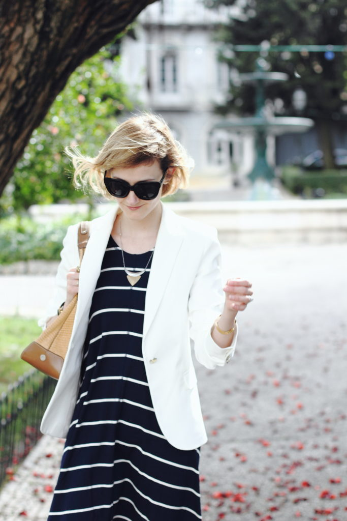 white blazer and striped navy dress