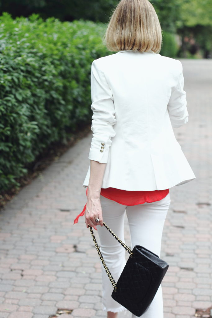 white blazer, white denim and chanel bag
