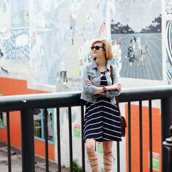 striped dress, denim jacket, and gladiator sandals