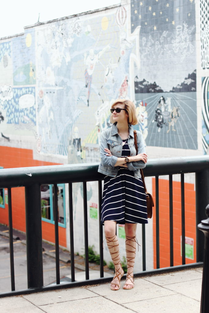 striped dress, denim jacket, and gladiator sandals