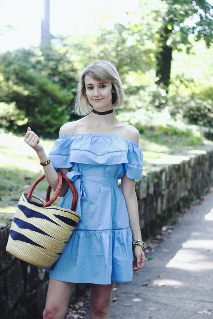 ruffled off-the-shoulder dress and straw bag