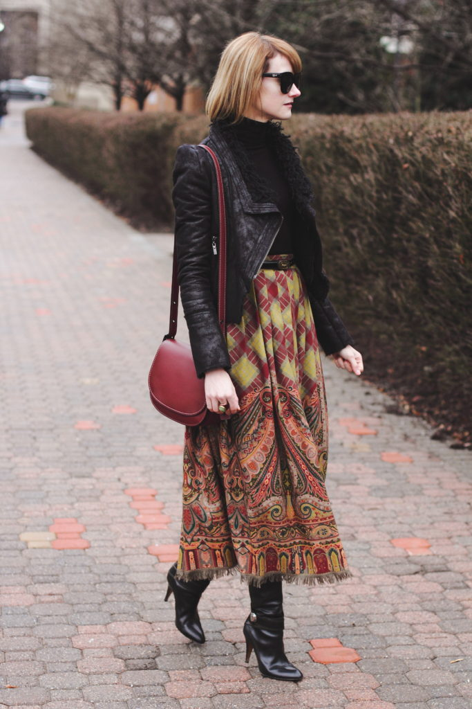 black turtleneck, leather jacket, and vintage brown skirt