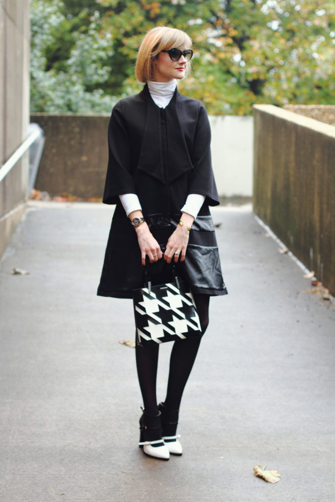 flared coat and white turtleneck