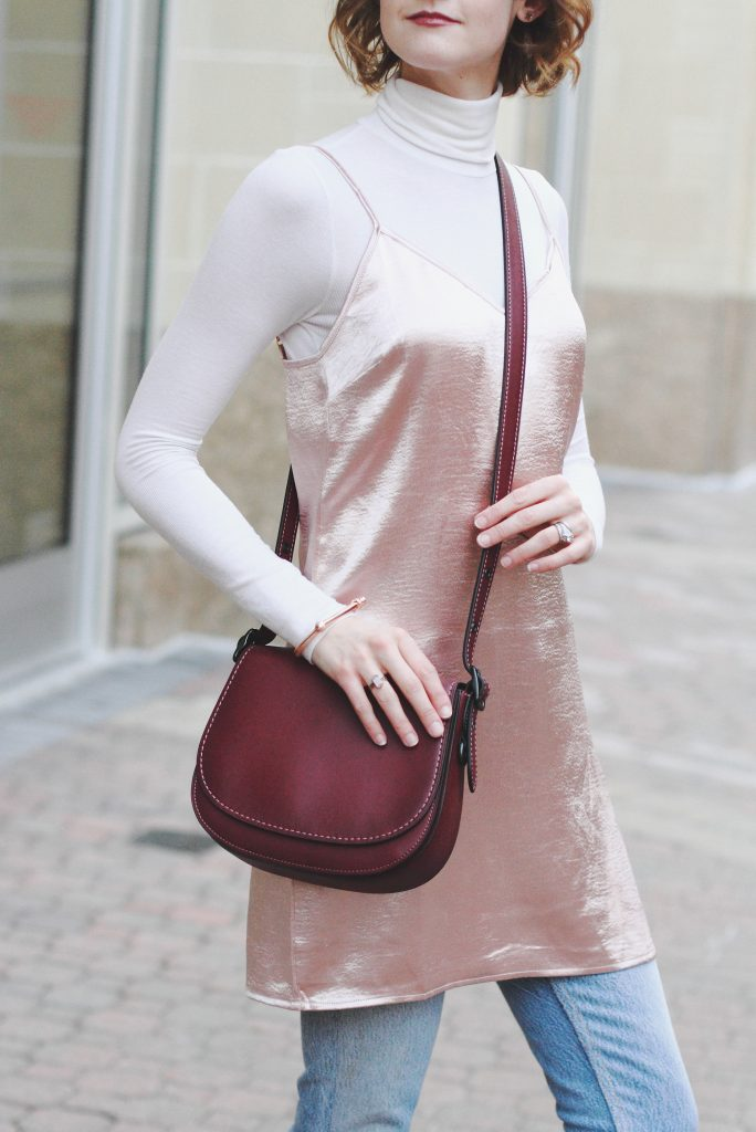 turtleneck, layering slip dress, and Coach bag