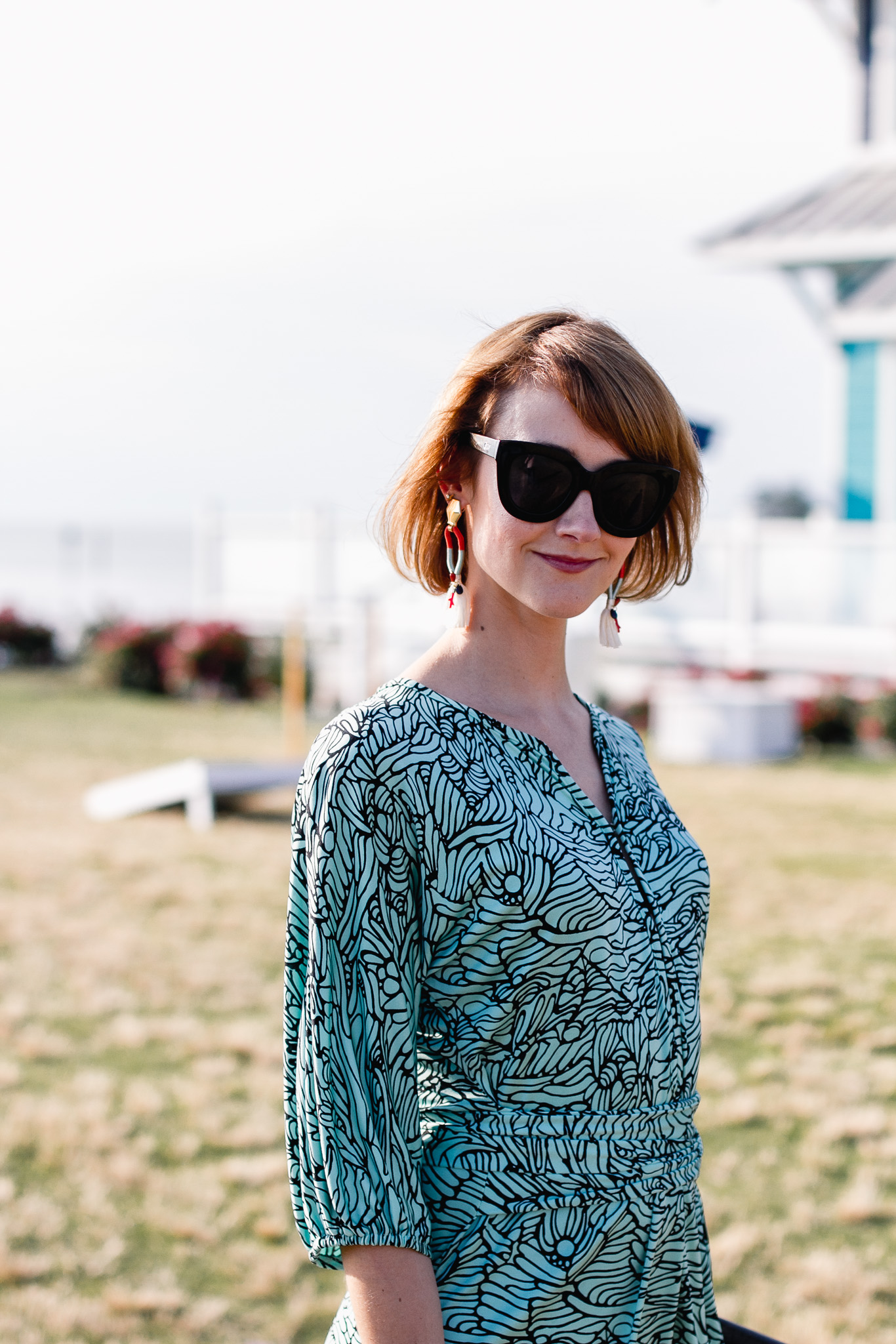 Quay sunglasses and Mara Hoffman mini dress