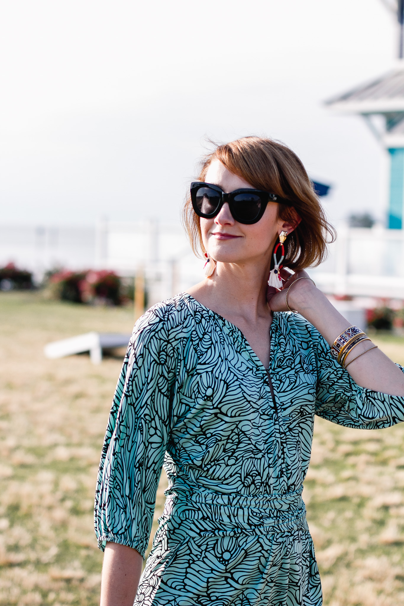 Quay sunglasses and Mara Hoffman mini dress