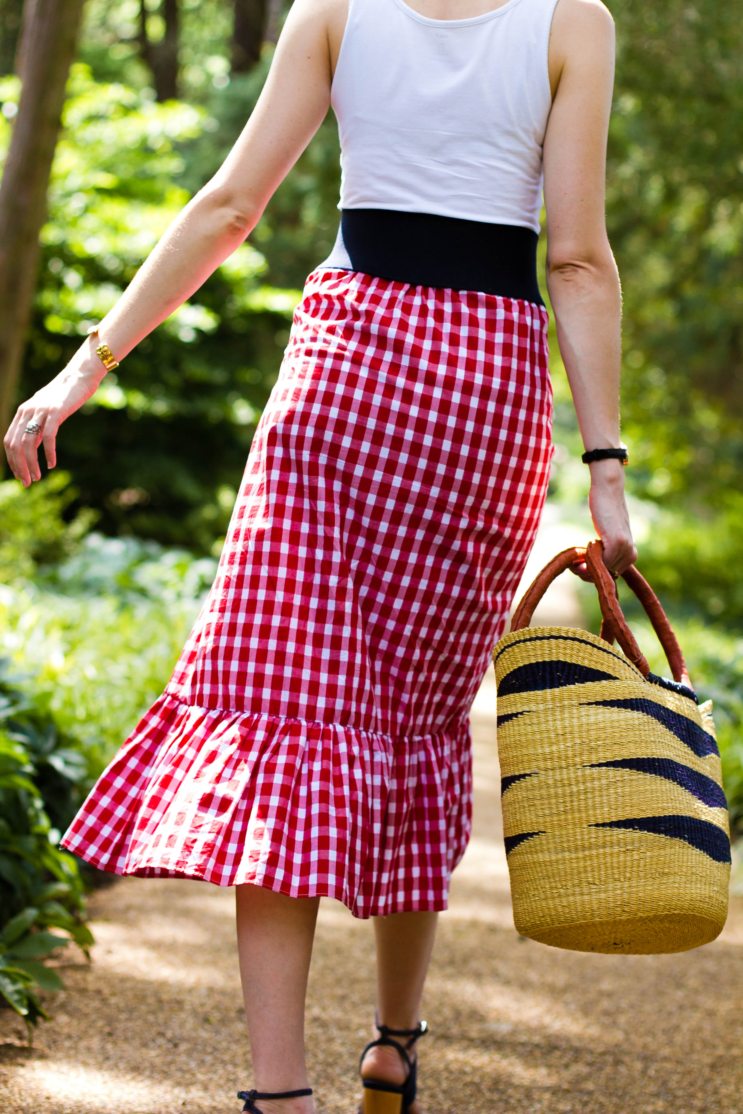 Zara gingham skirt, straw bag, and Cluse watch