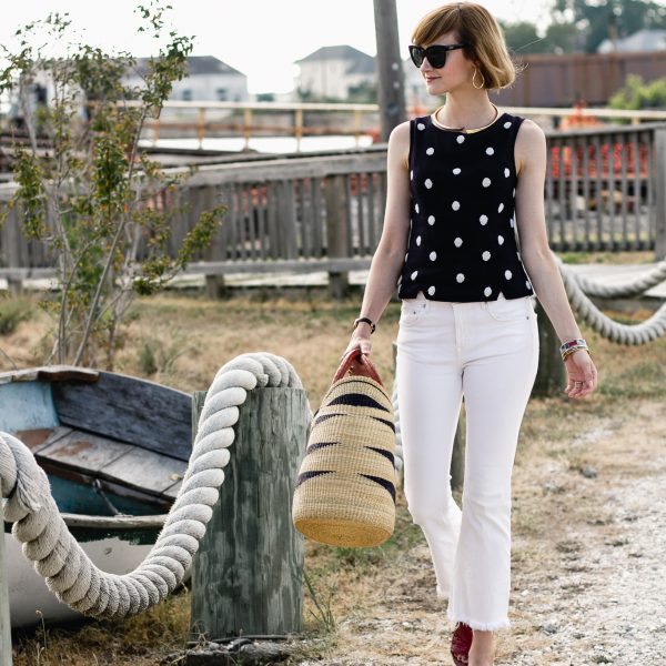 polka dot top, white denim, and red mules