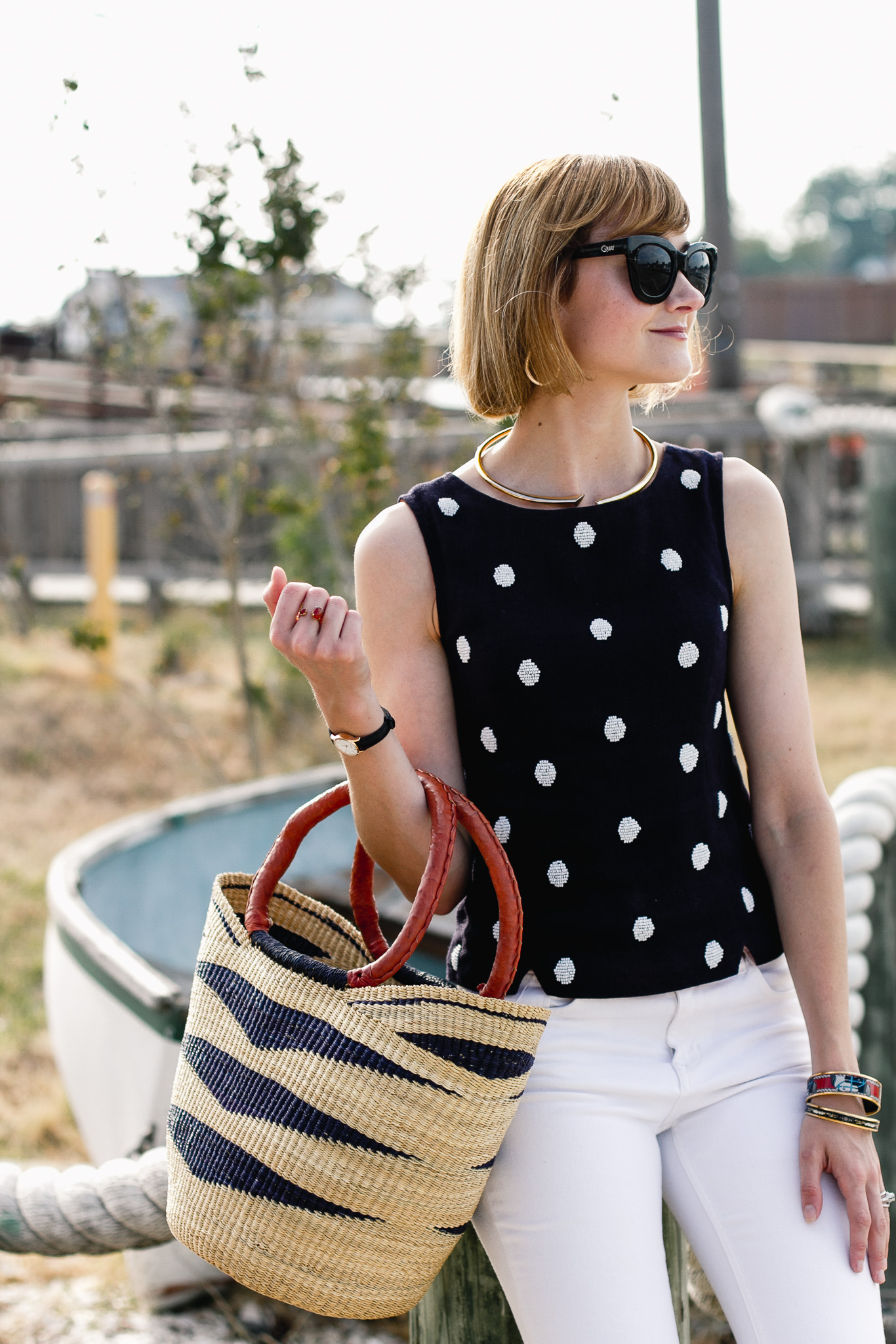 polka dot top, white denim, and straw bag
