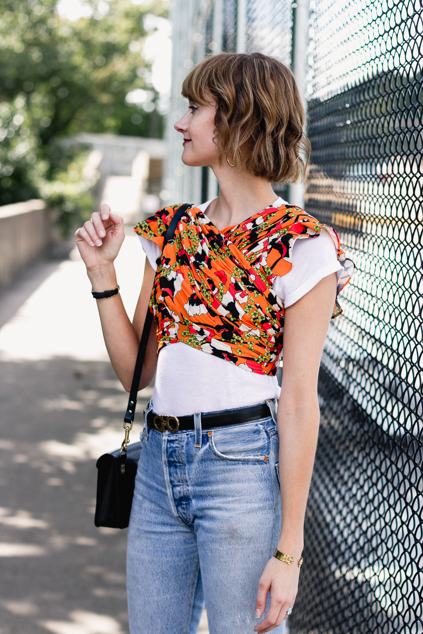 Mango crop top, Ferragamo belt, and Re/Done jeans