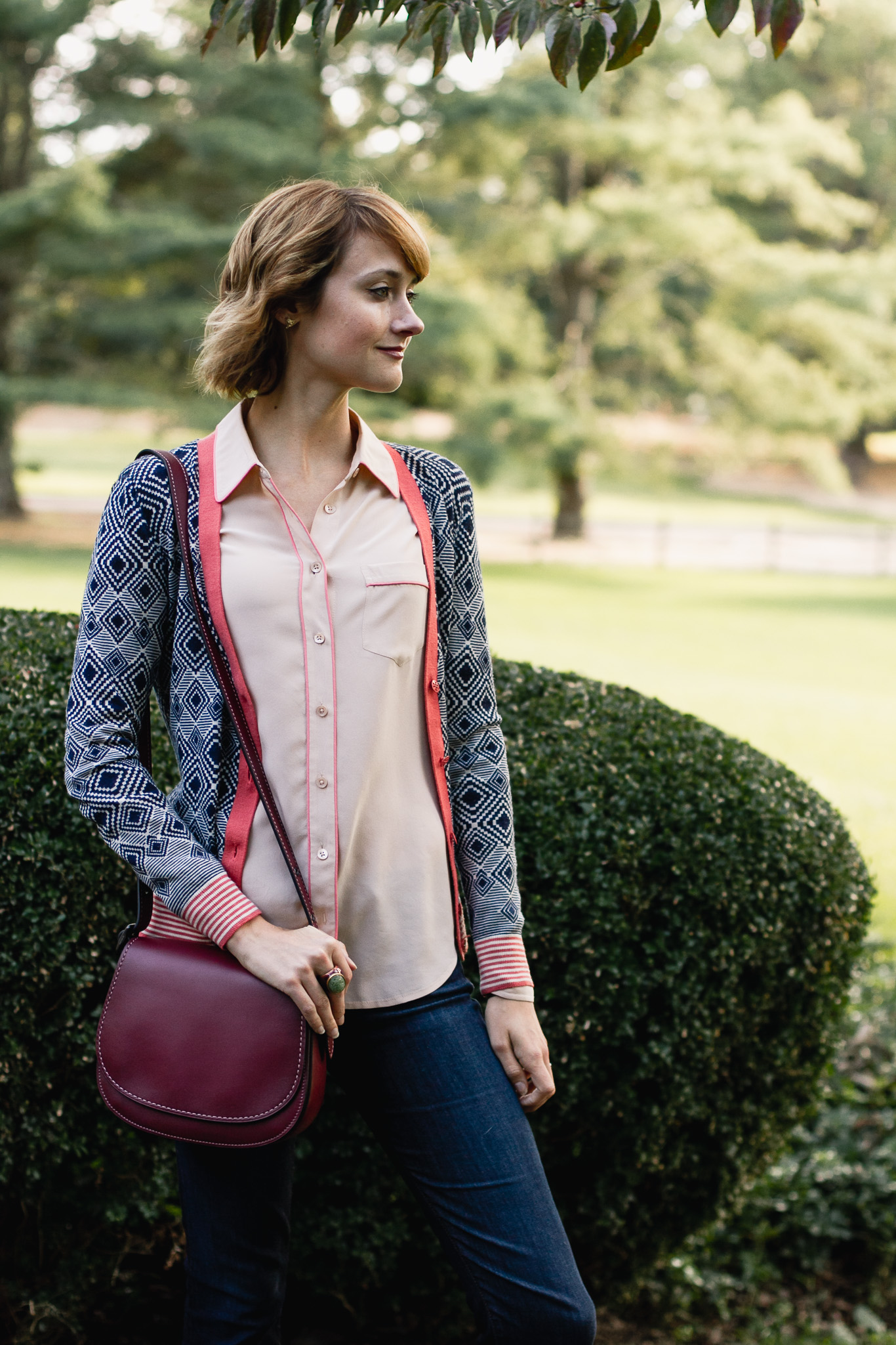Tory Burch cardigan, Equipment button-down, and Coach bag