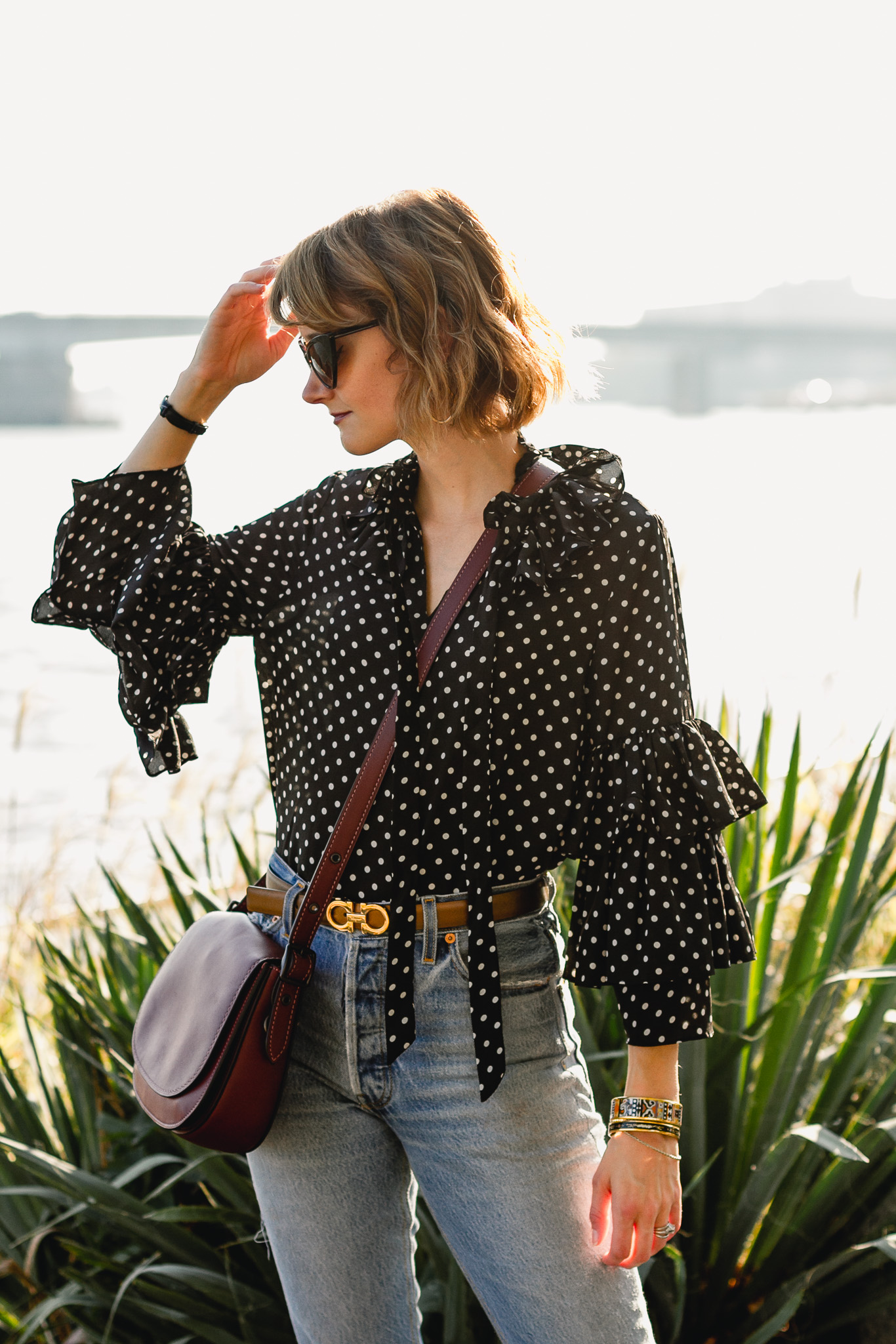 ruffled polka dot top, Ferragamo belt, and Coach bag