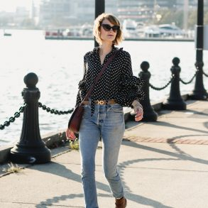 ruffled polka dot top, Ferragamo belt, and Re/Done jeans