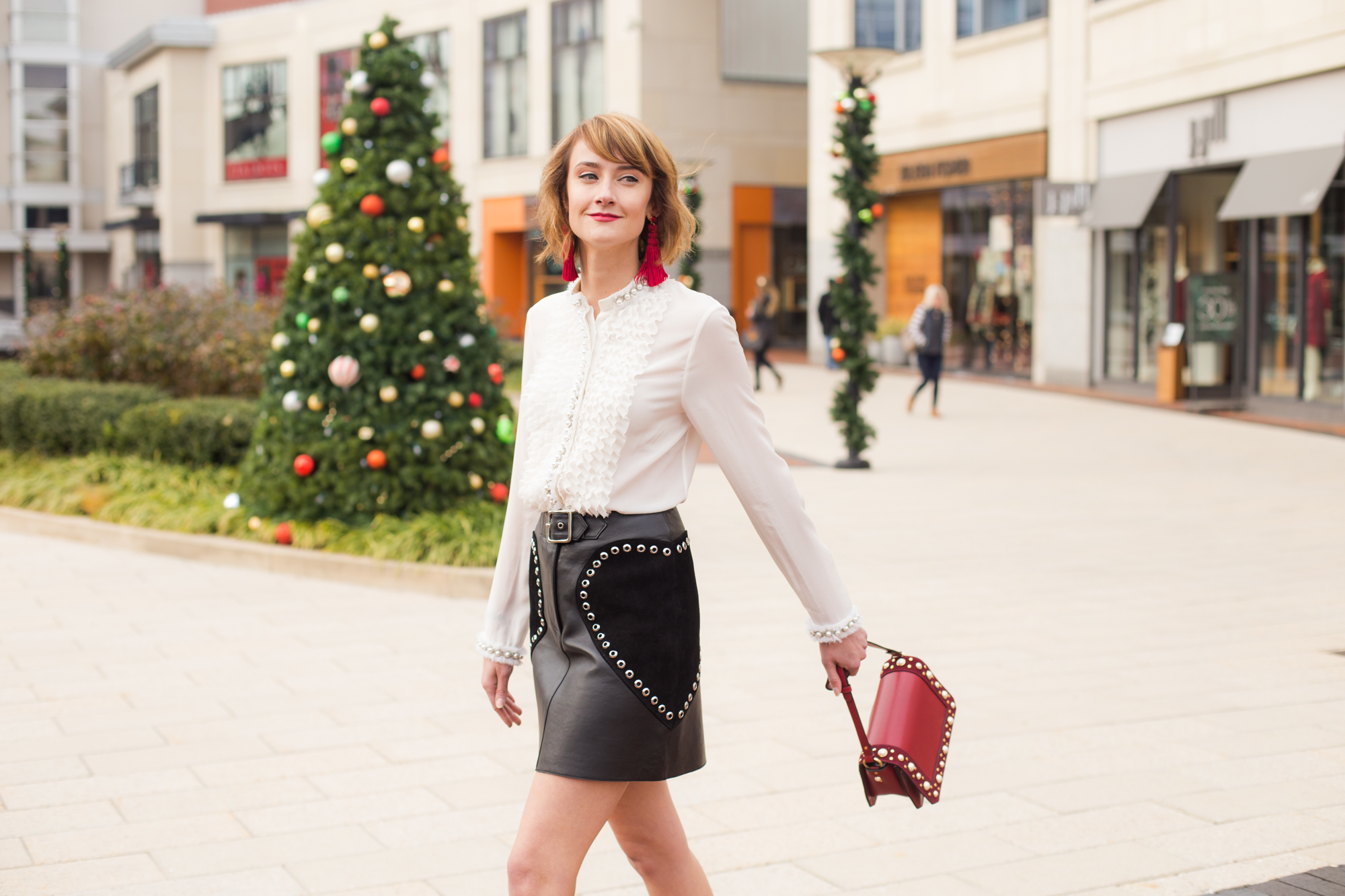 Alice + Olivia pearl-embellished blouse, Maje leather skirt, and Sandro bag