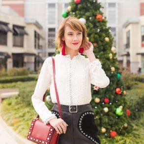 Alice + Olivia pearl-embellished blouse, Maje leather skirt, and Sandro bag