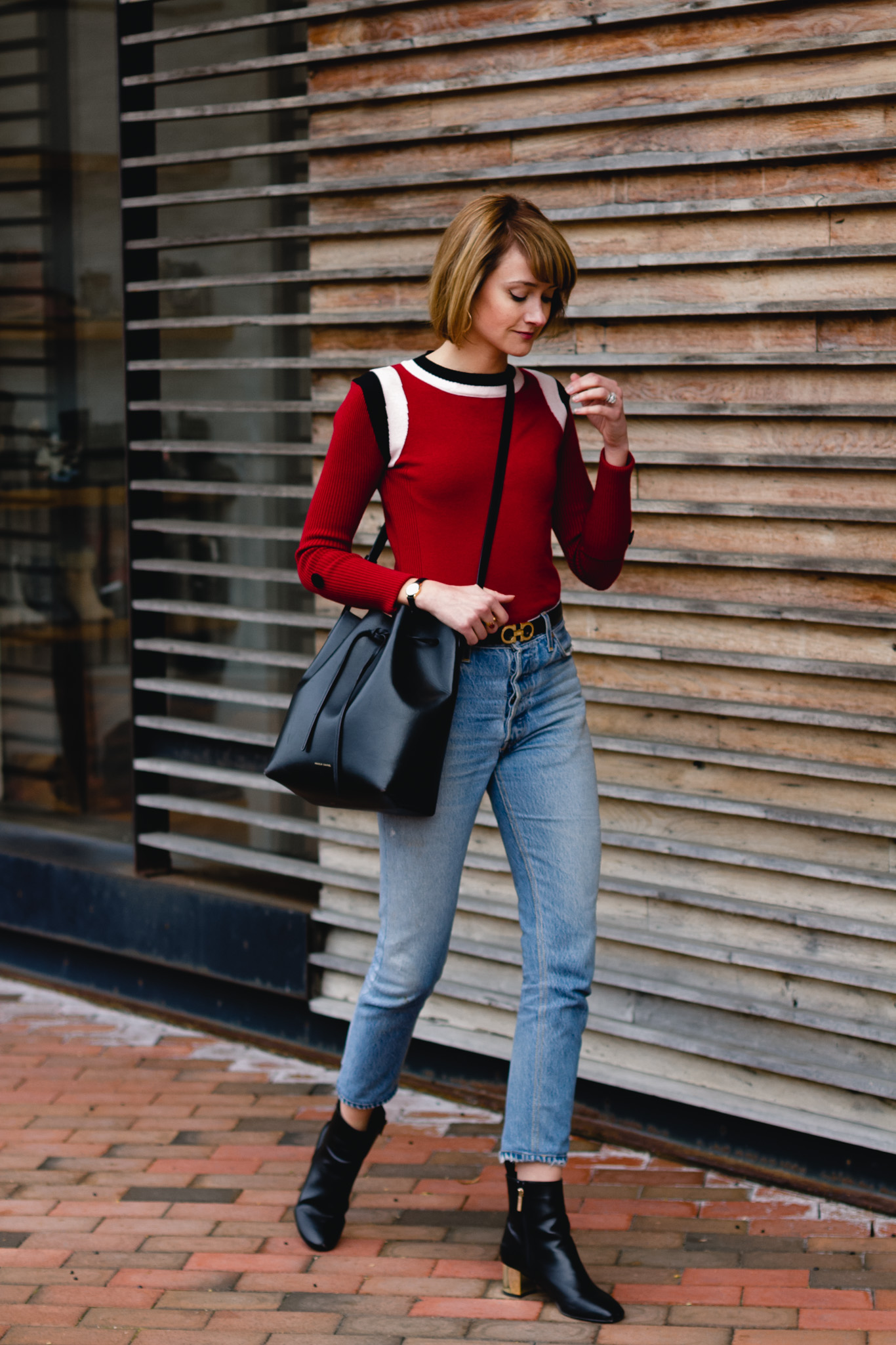 Marni sweater, RE/DONE jeans, and Mansur Gavriel bag
