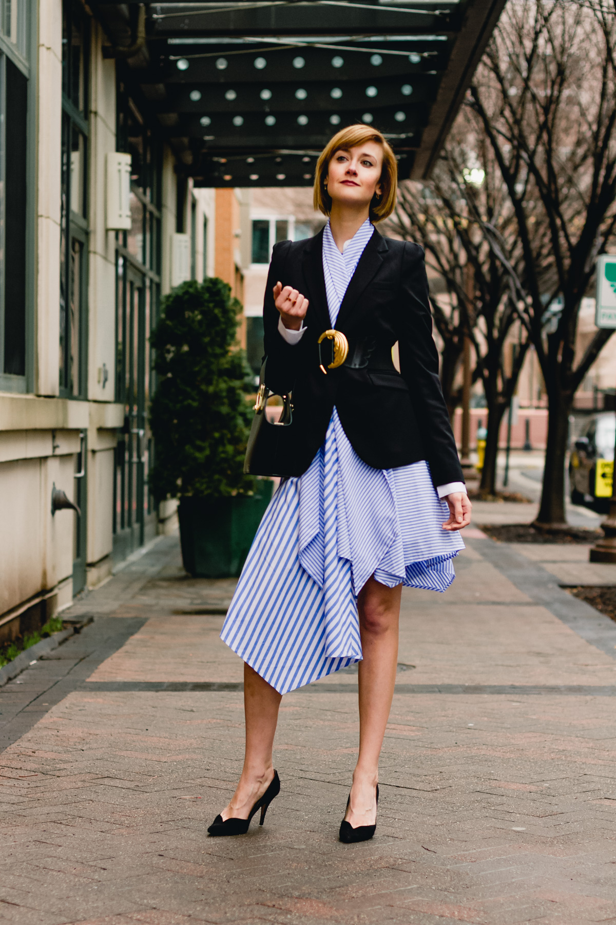 belted blazer and striped asymmetrical dress