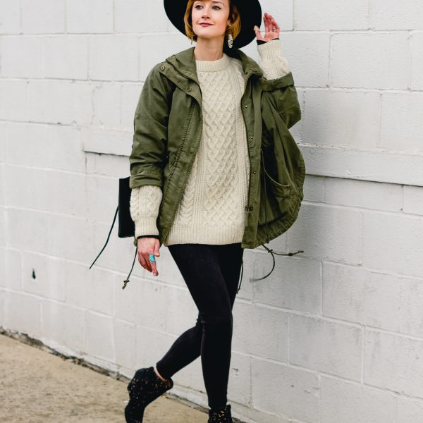 layered anorak, fisherman's knit, and suede leggings