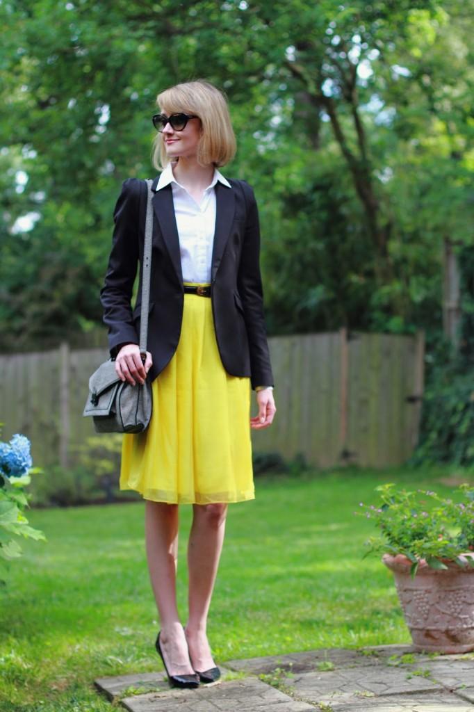 black blazer and yellow skirt