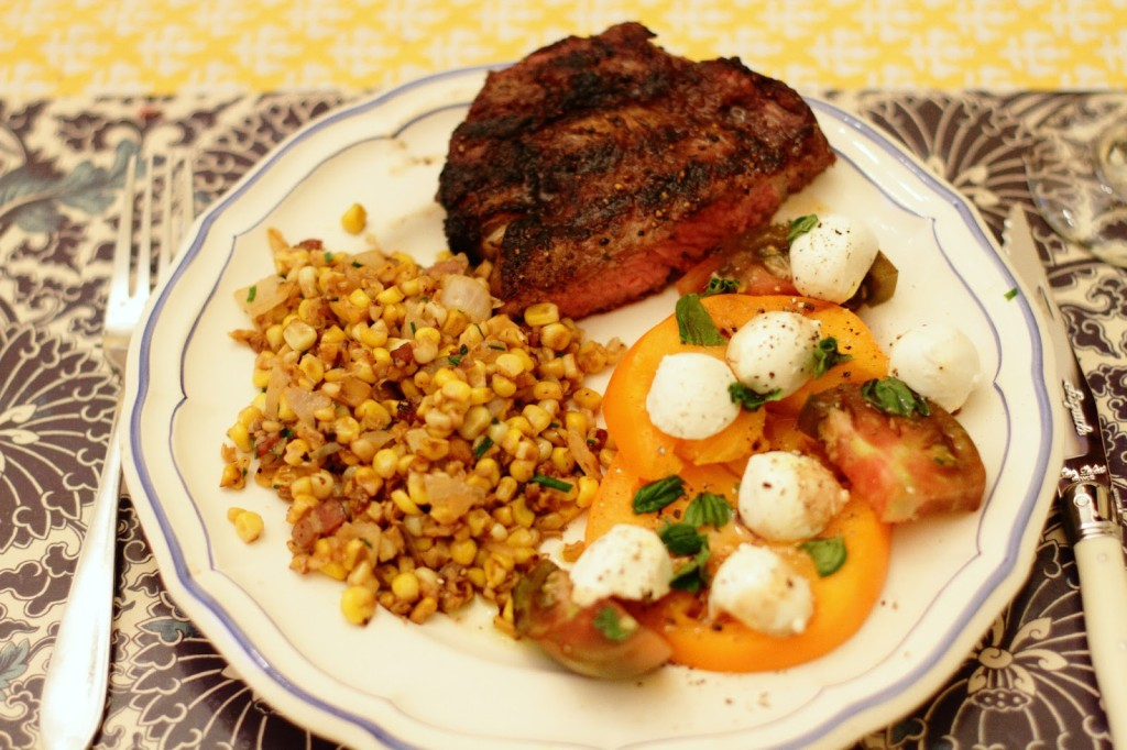 ribeye, cast-iron charred corn, and carprese