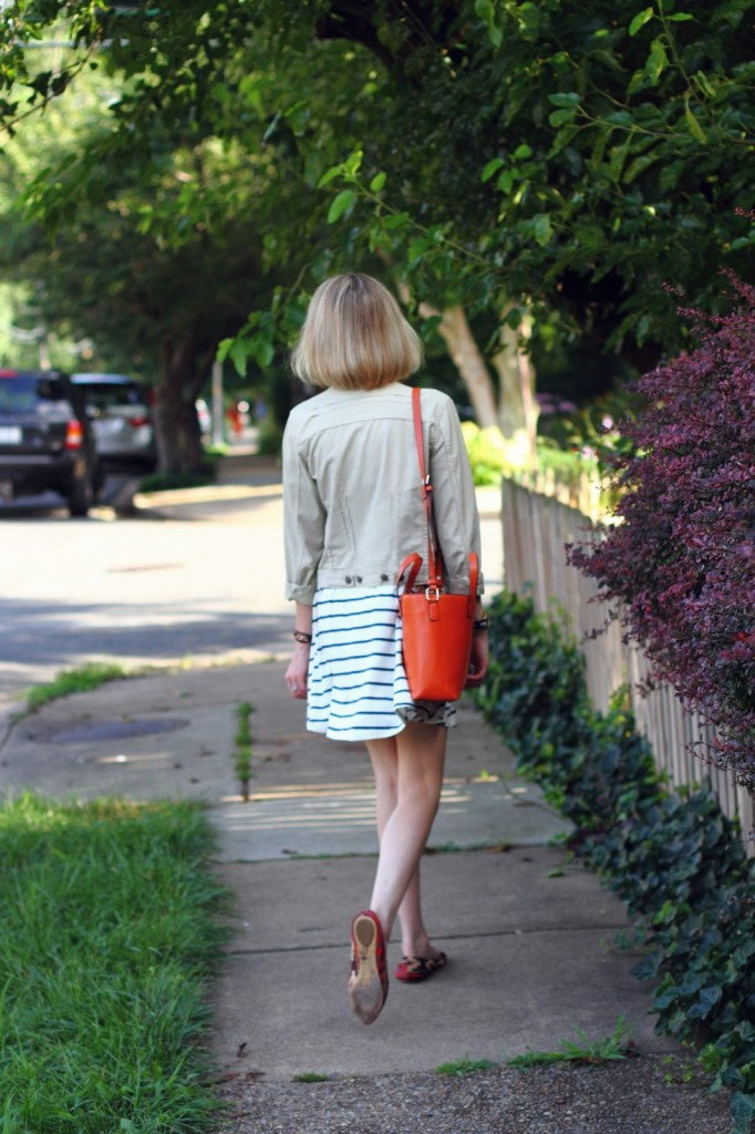 orange tote and navy striped swing dress