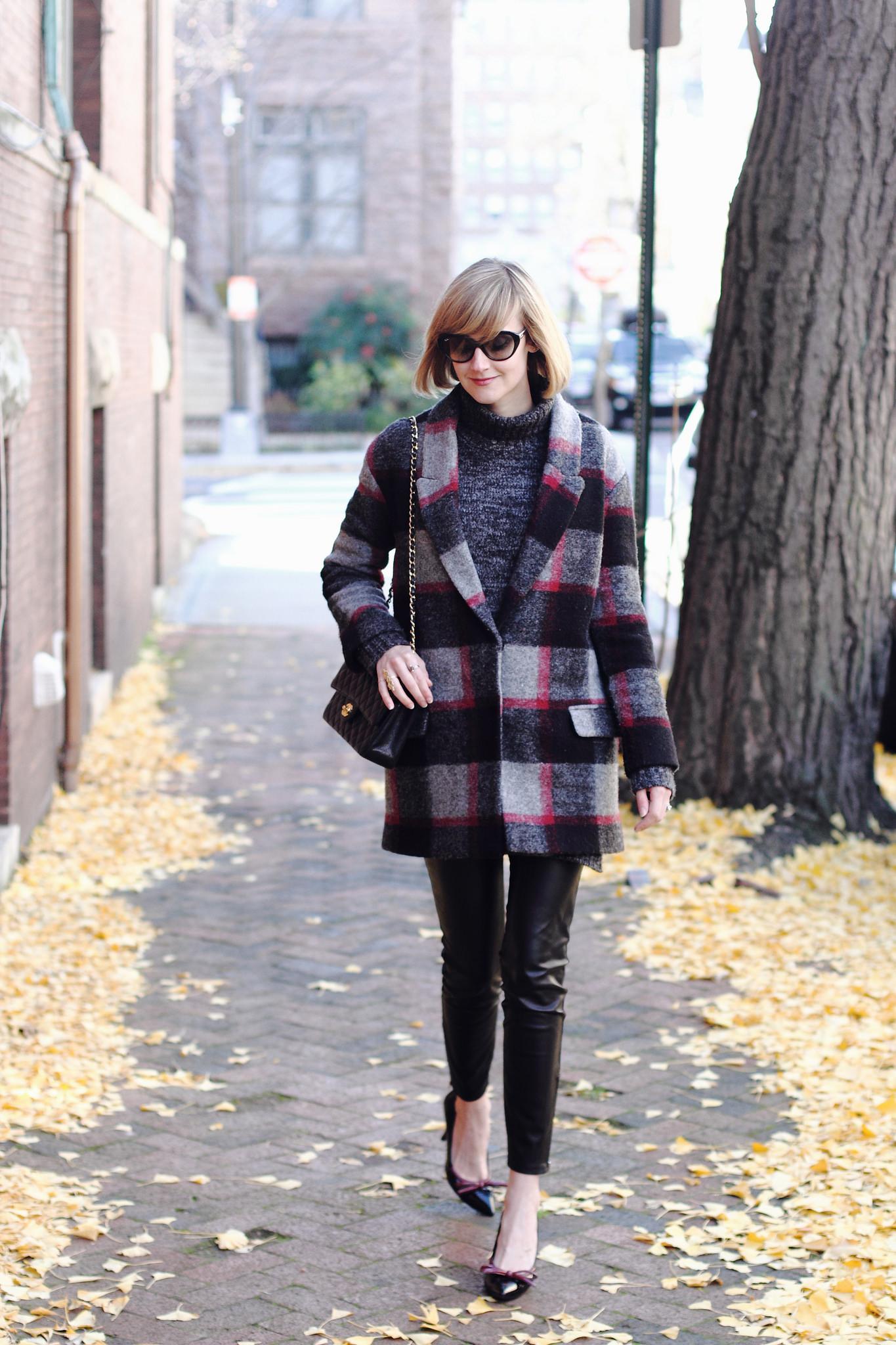 plaid coat and leather leggings