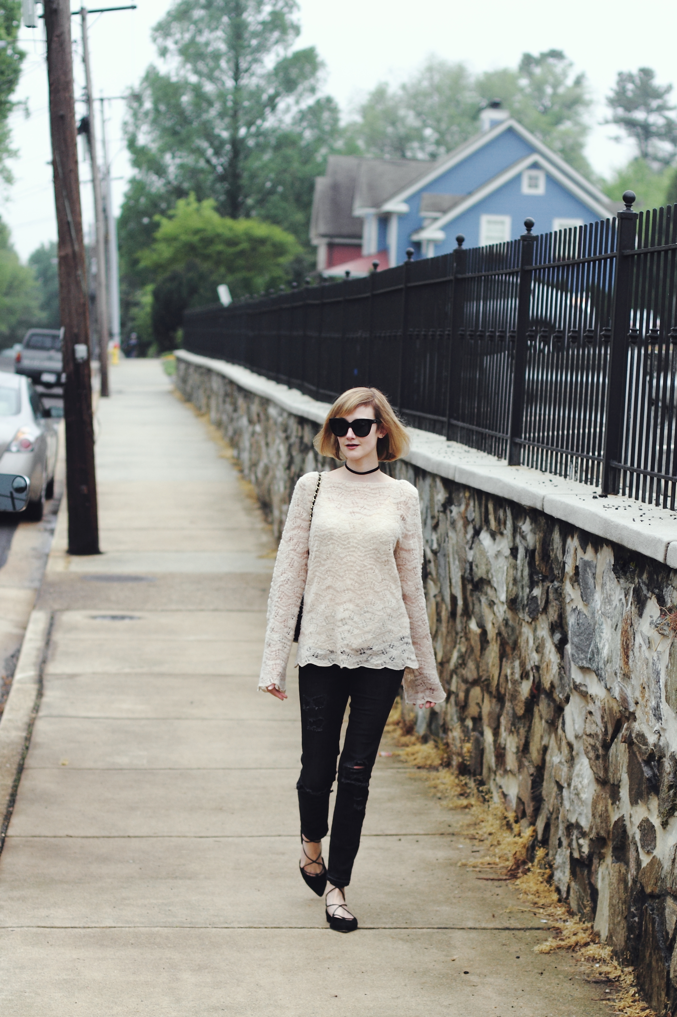 bell-sleeved sweater and distressed denim