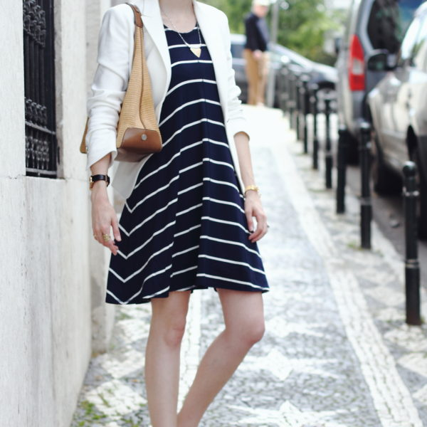 white blazer and navy striped dress