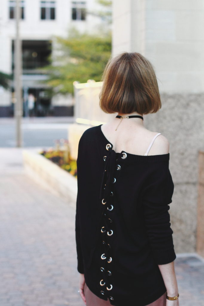 slip dress and lace-up sweater