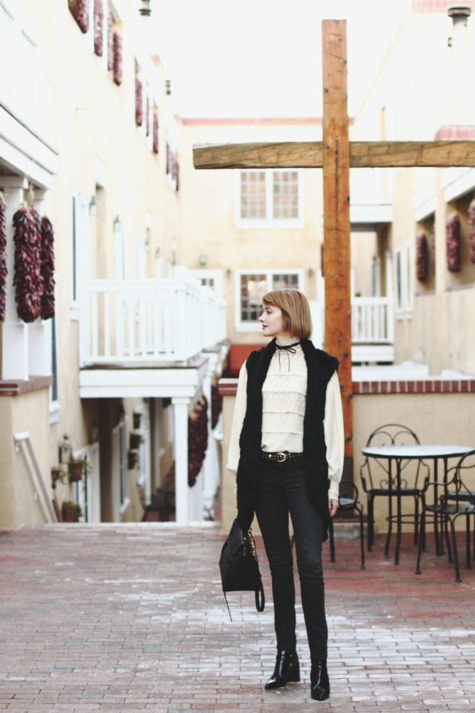 vintage lace blouse, fur vest, denim, and ankle boots