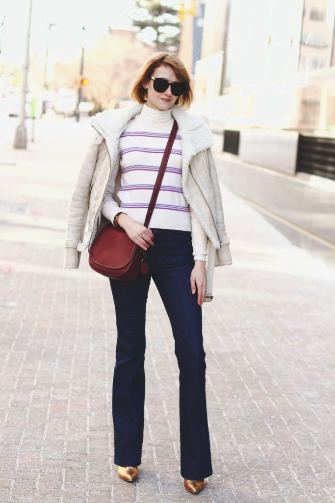 vintage ski sweater, flared jeans and Coach bag