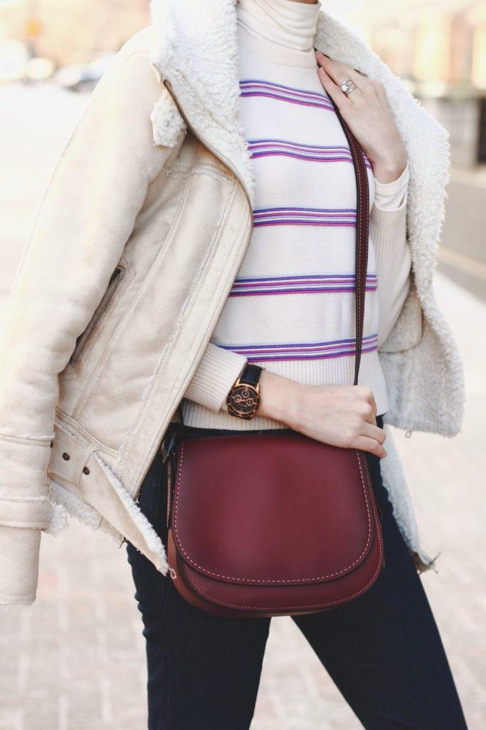 vintage ski sweater, shearling jacket, and Coach bag