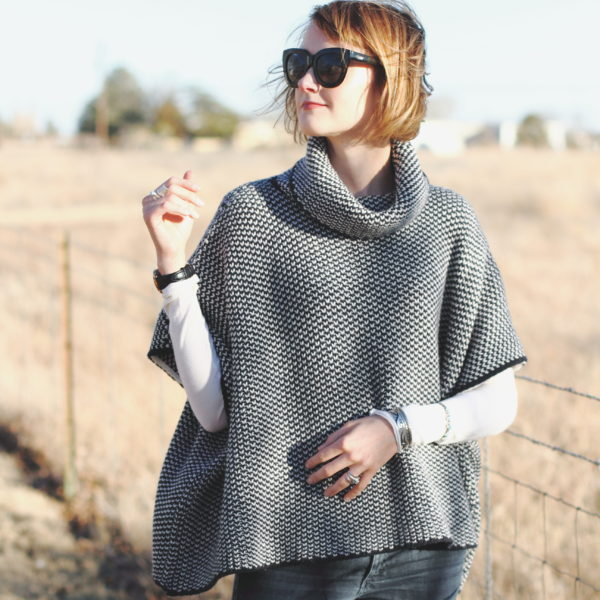 Woolovers poncho and Quay sunglasses