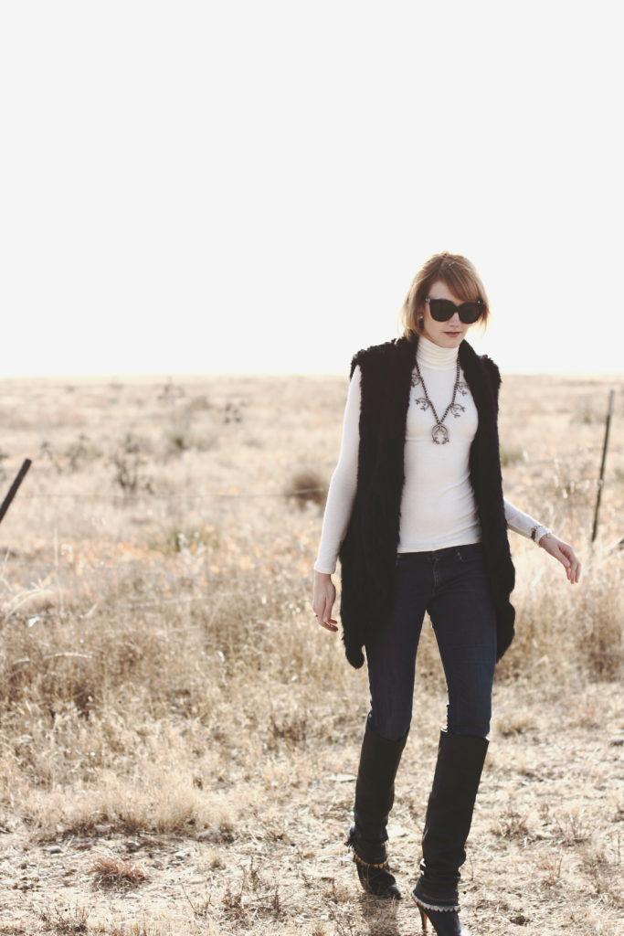 squash blossom necklace, fur vest and OTK boots