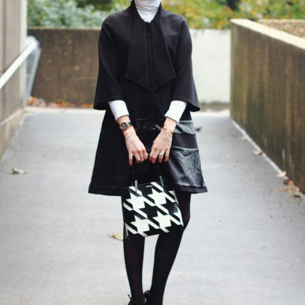 flared coat and white turtleneck