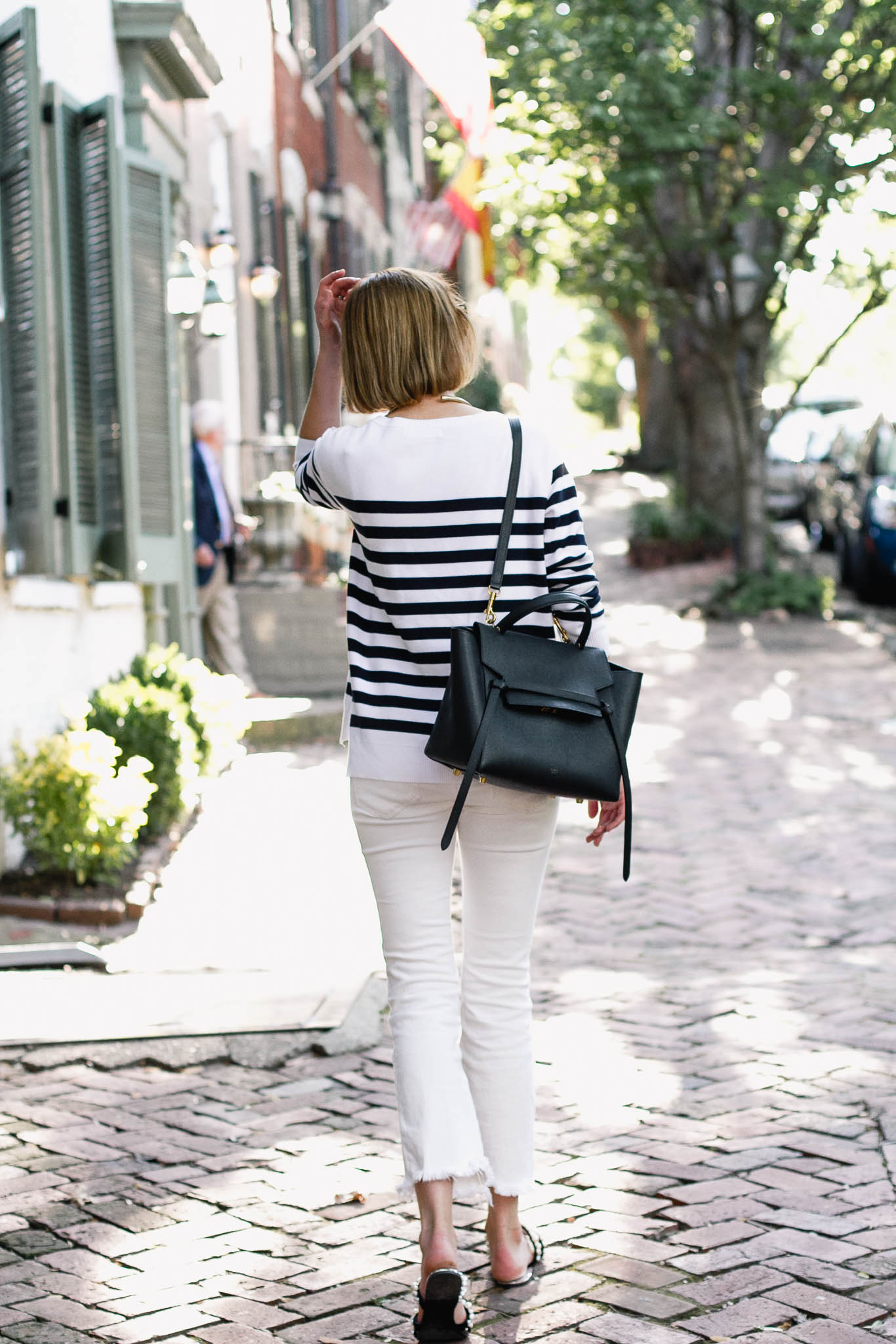 striped sweater, white denim, and pearl slides
