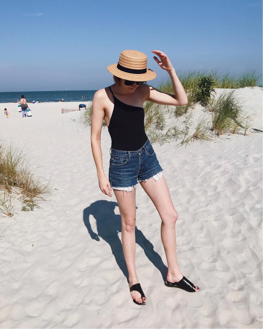 Alix one piece swimsuit, straw boater hat, and ATP Atelier sandals