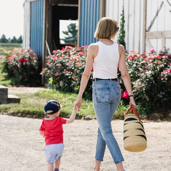 white tank top, Re/Done jeans and red mules